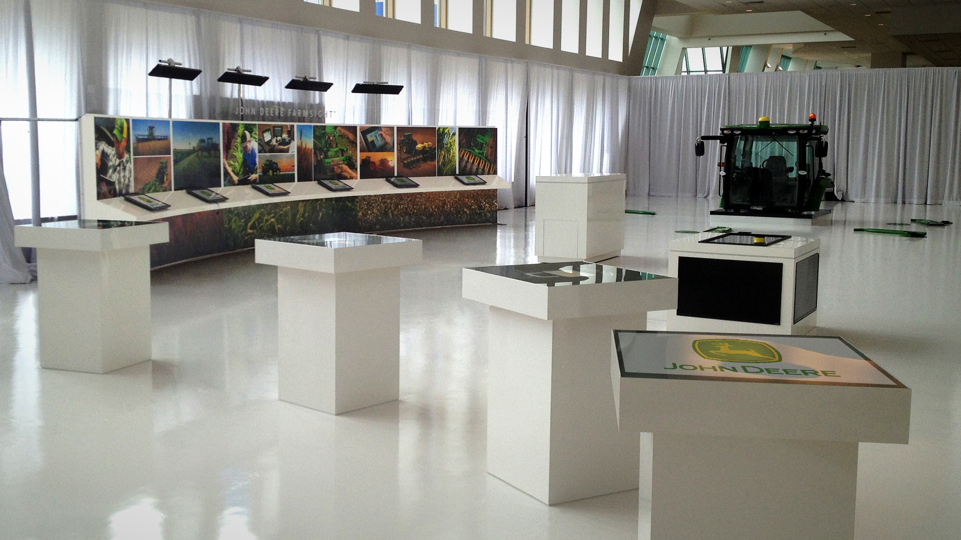 John Deere ISG Tradeshow Display with internally lit tabletops and individual touchscreen monitors